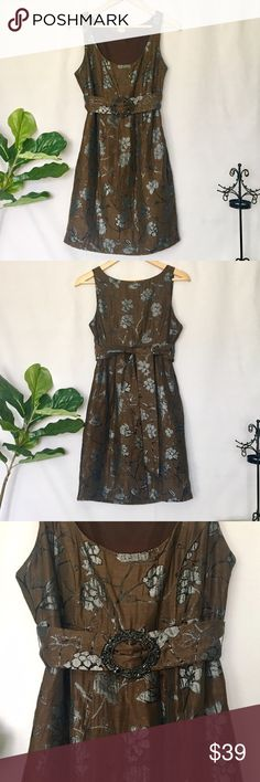 """Eva Franco Dress 4 Anthropologie Mod Retro Brown Eva Franco Floral Sheen Empire Dress Beautiful empire waist dress. Has a lovely sheen on the texturizing floral print. Sash tie. Faux belt. Grunge look. Size: 4 Color: Brown, silver, black Excellent condition. No stains, rips, or snags.  *Measurements: underarm to underarm: 18"""" Waist: 30"""" Length: 35""""  Thank you for looking! Check out my other listings. Anthropologie Dresses"""
