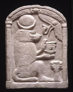 """imestone relief depicting the God Thoth in His form of sacred baboon wearing the Lunar disk with the Crescent, and holding the 'Udjat'-Eye on the ""neb""-basket; before Him is an altar, and above at right the Winged disk with the Uraeus; on the top of the stele, the Winged disk flanked by two Uraei. Dated to the Ptolemaic period (332-30 BCE). Now in the British Museum..."" ^**^"