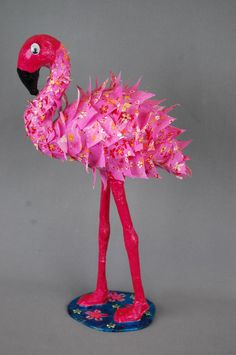 Decopatch decoupage feather effect paper decoration on a papier mache flamingo shape:  http://decopatchuk.blogspot.co.uk/2012/03/feathery-flamingo.html