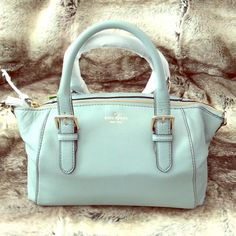 """H.P. Kate Spade Brighton Park Satchel 100% Authentic and brand new with tags a powder blue gorgeous Brighton Park Sloan purse. This Kate Spade handbag has smooth cowhide leather, custom woven library lining, top handle with zip top closure, adjustable removable shoulder strap, double slide pockets and interior zip pocket and the Kate Spade embossed signature and light gold stud.  Dust bag included. Only handled for photos! Still Sealed in the plastic! 8.6""""h x 12.1""""w x 5.5""""D kate spade Bags"""