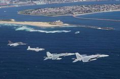 All four Air Combat Group aircraft; the PC-9, Hawk-127, F/A-18A Classic Hornet and F/A-18F Super Hornet, fly in formation in the airspace over RAAF Base Williamtown.