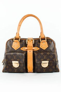 Louis Vuitton  Manhattan Gm. It's a well-known fact that I love large, heavy bags. But when it comes to Louis Vuitton, I also tend to gravitate toward the discontinued and the limited editions. This is my next target and I want it already patinated!
