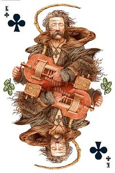 Ukrainian playing cards. Maybe my favourite from this deck because he is playing a donskoy ryley, (Russian: Донской рылей)  a stringed musical instrument from Russia. It is a type of hurdy gurdy, where the strings are constantly bowed by a wheel which is turned using a crank, and the pitch of the strings changed by keys attached to sliding tangents. How COOL! I like the added detail of hops on the sides.