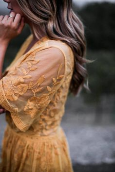 Gorgeous sheer lace yellow dress  (and nice photography too). Designer unknown.