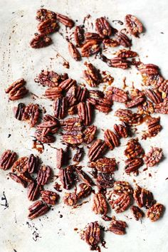 Maple Roasted Pecans | http://cookswithcocktails.com/maple-roasted-pecans/  veganize - use earth balance and coconut sugar, cinnamon replaces cayenne