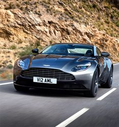 The Aston Martin is one of the most elegant grand tourer supercars available. Available in a couple or convertible The Aston Martin has it all. Carros Aston Martin, Aston Martin Vanquish, Aston Martin Sports Car, Aston Martin Db11, New Sports Cars, Sport Cars, Moto Design, Ferrari, Porsche 918 Spyder
