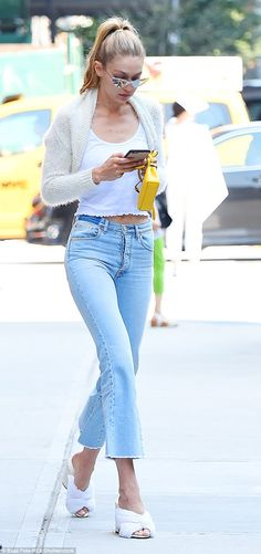 In the eye of a storm: Gigi Hadid looked somewhat downcast as she ran errands in New York City Tuesday after facing a fierce backlash from Chinese people over a 'racist' video