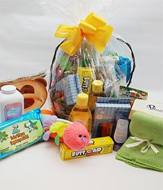 Baby Boy Gift Basket  Your Adorably wrapped new baby gift basket contains an assortment of necessities for the newborn including an embroidered bib, a one piece outfit, baby bottle, two snack containers and a rattle. All items are nestled in a charming 14 inch basket. $49.95