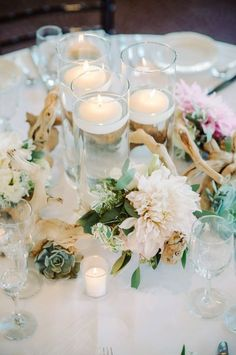 Table Centerpieces (1 per table). Driftwood wreath with succulents, eucalyptus, snow on mountain and Dahlias.