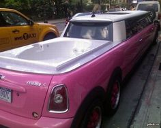 A rolling hot tub party with indoor amenities included, in a PINK MINI COOPER!