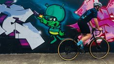 Cycling Socks by Cosmic Socks  Cyclists wearing electric blue model by graffiti on wall.  Alien.  #Cosmicsocks #cyclingsocks #sockporn #showusyourkits #sockheight #sockgame #sockdoping #socks #cyclegear #cyclinggear #kitporn #kitwatch #cyclestyle #cyclechic #kitspiration #cyclists #cycling #outsideisfree #roadcycling #cyclist #cyclinglife #roadcycling #instacycling #lovecycling #instacycle #cyclinglove #instabicycle #cyclistlife #cycleclothing #malvernstar #steelisreal⠀