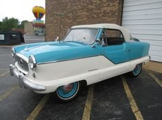 1960 Nash Metropolitan. LOVE these! My aunt had a red and white one... Wish she still did so I could steal it. Ha