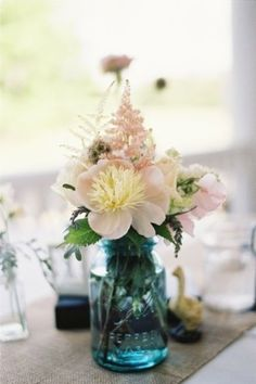 Photo by Loren Routhier on Southern Weddings The jar is great but maybe different flowers?