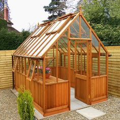 A Victorian styled, western red cedar greenhouse with medium oak aquastain finish with side opening vents. Optional staging and shelving are available. Available in a choice of ten lengths with a 10 year guarantee.