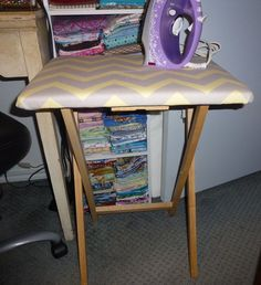 New space saving, small size folding ironing board or pressing table.  I made this using a wooden TV tray.  Top is covered with heat resistant batting and then covered with a stylish chevron gray and yellow striped, heavy weight, home goods cotton fabric to make it extra durable.   Ideal size for dorm room, sewing room, quilting, crafting, etc.  Perfect height - just swing around in your chair to press seams or whatever crafting project you're working on.  No more running back  SOLD
