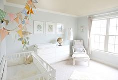 Amanda's comment: I love how calming and sophisticated this nursery is. Seems tranquil, but I love the bunting as a pop of color, too.