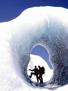 Hiking on the Svinafellsjökull is an unforgettable experience. Experience stunning ice tunnels like this one.