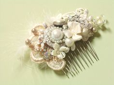 Feather & Pearl Bridal Hair Comb- Couture Collage Wedding Hair Piece- Vintage Wedding Hair Accessories- Statement Bridal hairpiece. $59.00, via Etsy.