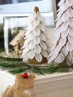 Blogger Challenge: HGTV Holiday House Fireplace Mantel Design: Clever DIY projects like these trees made with plastic spoons make Kim's mantel unique. Find all her mantel decoration projects here. From DIYnetwork.com