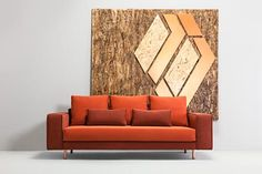 Burnet orange statement sofa with copper coloured legs.