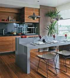 Great design of the dining space incorporated into the kitchen bench.