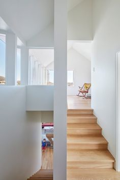 Inside the home, the architects joined its two parts seamlessly. Large, minimally framed windows were inserted across the building, while white-washed walls and light-wood flooring throughout help to reflect the added light and make the interior feel spacious.