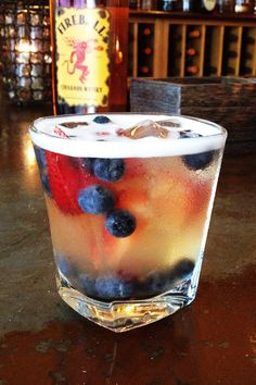 """To add some spark to the 4th of July weekend (and beginning of the summer season) we're offering up some fire works of our own! Our in-house mixologists have come up with a new cocktail, the Fire Rocket - a perfect way to blast-off into summer's numerous and exciting adventures! The Fire Rocket is a refreshing concoction of Fireball Whiskey with fresh homemade lemonade and garnished with blueberries and strawberries! Can you say, """"Get your red, white and blue on!"""" Happy Independence Day!"""