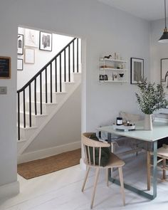 How to update your home this summer without buying anything new. Open plan kitchen space with white stairs and black handrail
