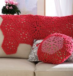 I love the Cranberry Mosaic Web Throw and Pillow. It's a stunning crochet afghan pattern that will instantly make a statement in any room.