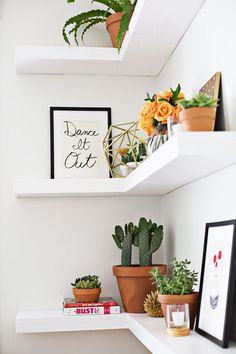 Floating shelves for kitchen corner...paint same color as wall or keep white so they look more customized.  Display little artwork, family pieces, orchid.
