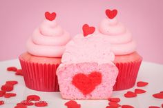 makebakecelebrate: Heart Filled Cupcakes for Two  cut the red cake (using heart cutter or flower cutter) then Line a cupcake pan with your cupcake liners. Spoon in 1 TBS of pink cake batter into the liners.  Then gently push your heart cake into the batter, center and facing flat to the front