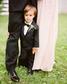 Proof that a kiddo's never too young to look dapper. This ring bearer rocked a tux at Alanna and Craig's part New Jersey, part Pennsylvania celebration. View more pics from this rustic black-tie barn wedding by following the link!