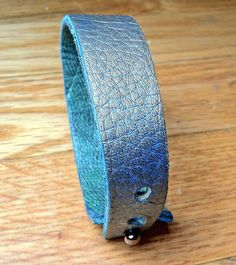 #handmade #leather #accessories on Etsy This leather wrist #cuff is handmade using leather remnants, repurposed, recycled but new pieces of leather I purchase by the pound. Every piece is #unique, and that is how I... #trending #etsy #jewelry #bracelet #jewelry #bracelet #rivets #blue