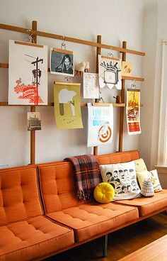 Hang your photos with vintage wooden hangers.