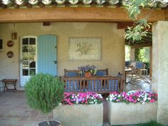 Spanish style Veranda / Ooo...This could work for my front porch only I would put up a trellis for more privacy.. :)