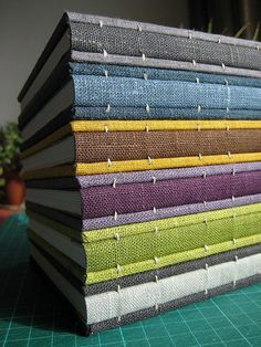 Coptic bindings with linen spines. Beautiful textiles, lush color palettes, gorgeous bindings.