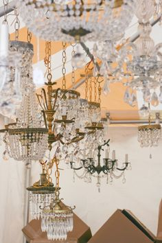 this ceiling of chandeliers at the brimfield antique fair has us dreaming of throwing extravagant parties. (kate spade new york home)