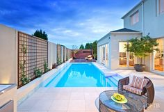 OFTB Melbourne landscaping, pool design & construction project - pool inc. feature wall, pool lounge inc. bench & screen, climber screen, terraces inc. bbq, garden beds, lawn