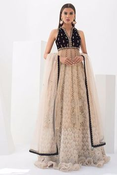 Chanel traditional feminine charm and revel in the beauty of this monochromatic net hand worked peshwas with net embellished dupatta with tassel detailing. Pair it up with Jamawar hand work lehnga perfect for an elegant day wedding. Desi Wedding Dresses, Pakistani Formal Dresses, Indian Dresses, Indian Outfits, Wedding Outfits, Simple Lehenga, Fancy Dress Design, Indian Couture, India Fashion