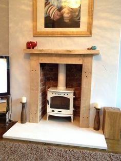 White enamel multi fuel burner, limestone hearth and oak surround (Like the wooden fireplace and brick but not the white fuel burner, would like black) Wooden Fireplace, Rustic Fireplaces, Home Fireplace, Faux Fireplace, Fireplace Ideas, Wooden Fire Surrounds, Shabby Chic Wallpaper, Log Burner, Hearth And Home