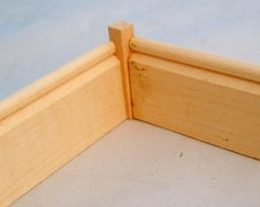 Tired of mitering corners? It's difficult at times and wastes your baseboard. A simple block like this one from Manchester Dollhouse & Wood Works on ebay solves the problem!