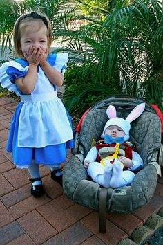 A toddler Alice in Wonderland and her baby White Rabbit! Awww