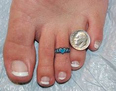 Toe rings are small ring(s) worn on/ around the toes. The basic design of toe rings feature a band or ring that hugs around the toe like a ring hugs around the finger. Toe Ring Tattoos, Ring Tattoo Designs, Body Art Tattoos, Small Tattoos, Tatoos, Tasteful Tattoos, Heart Tattoos, Butterfly Tattoos, Tiny Tattoo