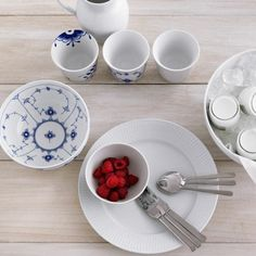 Kay Bojesen Grand Prix knife and spoon. Royal Copenhagen plate, bowls, cups, and jug.