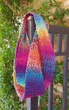 Colorful crochet infinity scarf using the moss/granite stitch