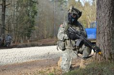 U.S. Army Soldiers of Alpha Troop, Regimental Support Squadron, 2nd Cavalry Regiment provides security while reacting to a simulated chemical attack during exercise Saber Junction 15 at the U.S. Army's Joint Multinational Readiness Center in Hohenfels, Germany, April 14, 2015.