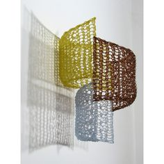 Crocheted fiberglass with polyester resin. By Yvette Kaiser Smith. The texture is nice as well as the shadow produced.