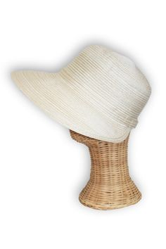 Handmade of natural materials, this sophisticated UPF 50 poolside perfect sun hat will keep the sun off your face. Unique brim focuses protection in the front.