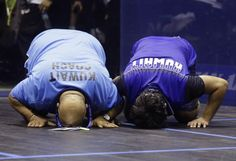 Kuwait's Abdullah Al Muzayen, right, and his coach Mohamed Nasser Sayed Zahran kiss the ground in celebration after defeating Saurav Ghosal of India during their Men's Singles squash final match at the 17th Asian Games in Incheon, South Korea, Tuesday, Sept. 23, 2014. (AP Photo/Dita Alangkara) ▼23Sep2014APviaYahoo!News|Sun wins 400 as China dominates Asian Games pool http://news.yahoo.com/sun-wins-400-china-dominates-asian-games-pool-145354310.html #Incheon2014