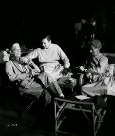 1935 Left to right: Actors Boris Karloff, Colin Clive and Ernest Thesiger pause for a cigarette break on the set of 'Bride of Frankenstein,' directed by James Whale. They are still in costume as two mad scientists and a monster. Classic Horror Movies, Horror Films, Horror Art, Horror Stories, True Stories, Legends Of Horror, Frankenstein Film, James Whale, Frankenstein's Monster